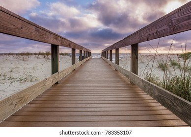 Low Angle of Morning Clouds Over Boardwalk Access to Beach