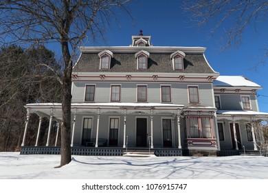 Low angle on a beautiful old house. Winter season.