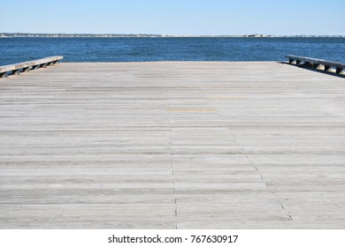 low angle perspective of wooden pier blurred background
