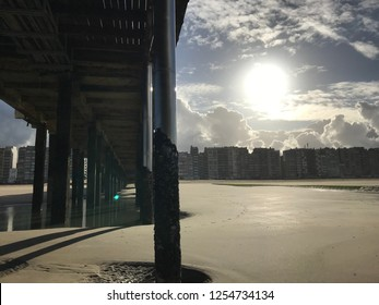 low angle pier blankenberge in winter with back light