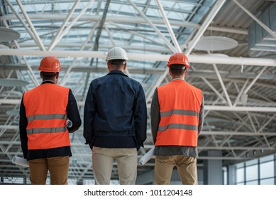 Lowarea images stock photos vectors shutterstock low angle of qualified engineers in safety helmets are standing at construction area they malvernweather Image collections
