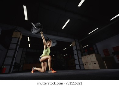 Low angle shot of an athletic woman performing lunges with a barbell at the gym copyspace butt buttocks workout weightlifting WOD crossfit sportspeople living leisure. Crossfit and fitness, deadlift