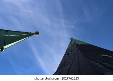 A low angle shot of beautiful architectural details of the St  Olaf's Church against a blue sky in Tallinn, Estonia