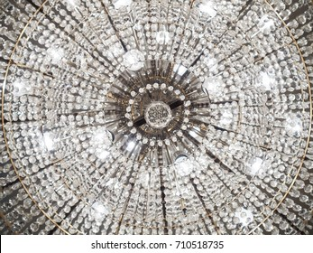 Low angle shot of beautiful chandelier that shine bright with clear crystal ornaments, good for texture, background or decoration.