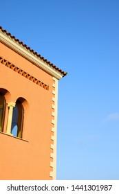 Low angle shot of beautiful orange villa in sunny Spain