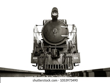 Low angle shot Front of Image black and white retro vintage style of Train Old steam locomotive Pacific on the tracks from Thailand isolated on white background.