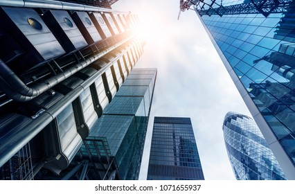low angle shot of futuristic glass and steel office towers in London financial district, London, Great Britain