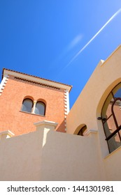 Low angle shot of grand ,traditional villa in the Spanish sunshine