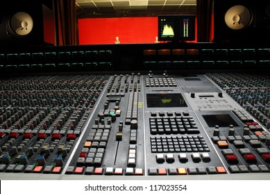 Low angle shot of a mixing desk in music studio