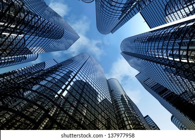 Low angle shot of modern glass city buildings with cloudy sky background.