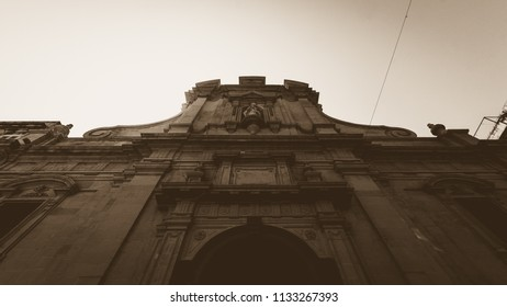 Low angle of St Nicholas Church Valletta Malta, High Contrast Sepia Tone Summer 2018 Baroque architecture