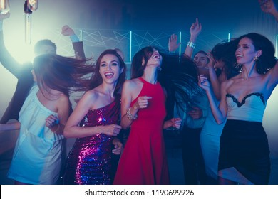 Low angle top view of fancy, style, trend, adorable, good-looking ladies in skirt, dress dance on party in night club raised hands up, closed eyes and laugh