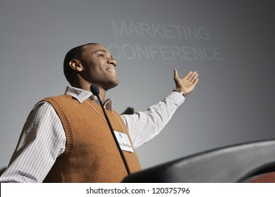 Low angle view of an African American businessman giving a speech on podium