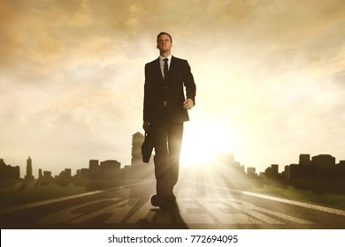 Low angle view of American businessman walking above career word on the road while carrying a briefcase