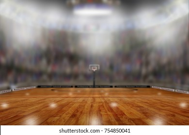 Low angle view of basketball arena with sports fans in the stands. Focus on foreground with deliberate shallow depth of field on background and copy space.