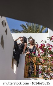 low angle view of beautiful stylish girls in sunglasses looking away at resort in Egypt