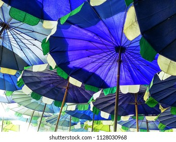 Low Angle View of Blue Parasols at the Beach