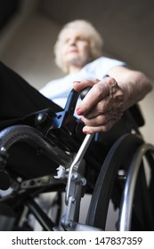 Low angle view of a blurred senior woman operating wheelchair