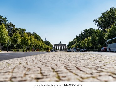 low angle view of Brandenburg Gate and 17 June Street in Berlin, Germany on sunny summer day