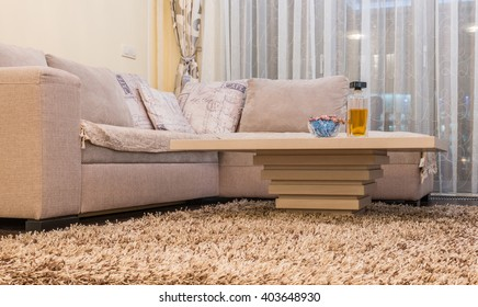 Low angle view of coffee table and white sofa