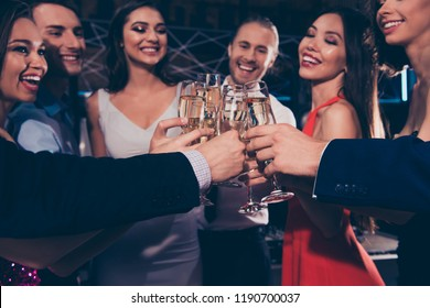 Low angle view, cropped close-up of nice attractive beautiful charming slim glam winsome stylish trendy cheerful ladies and rich gentlemen's wine glasses, chill out at fasionable night club, gathering