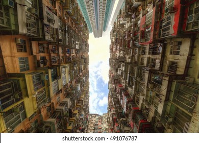 Low angle view of crowded residential towers in an old community in Quarry Bay, Hong Kong ~ Scenery of overcrowded narrow apartments, a phenomenon of high housing density & housing blues in HK
