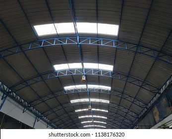 Low Angle View of Curved Steel Roof Structure