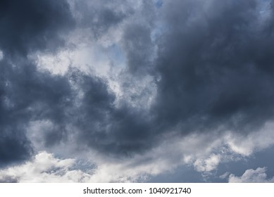 Low angle view of dark clouds on the sky