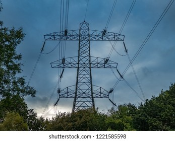 Low angle view of electricty pylon, near the river Goyt, Woodbank Park, Stockport, Cheshire, UK