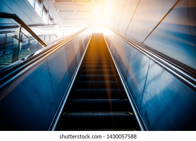 Low angle view of escalator,blue toned,China.