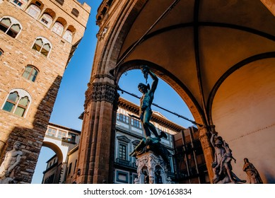 low angle view of famous statue of Perseus holding head of Medusa, Loggia de Lanzi, Florence