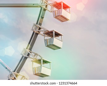 Low angle view of ferris wheel cabins. Blue sky background