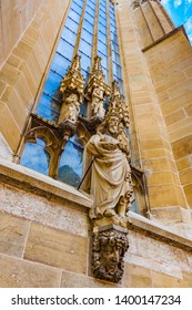 Low angle view of fine religious sculptures at the façade of the St. James Church (St. Jakob) in Rothenburg ob der Tauber, Germany. The historic church was finished in 1485 after 173 years of work.