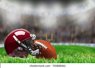 Low angle view of football helmet and ball on field grass and deliberate shallow depth of field on brightly lit stadium background with copy space.