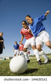 Low angle view of girls playing soccer