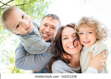 Low angle view of happy family in autumn park
