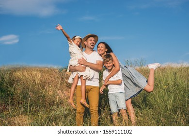 Low angle view of happy family enjoying in spring day in nature