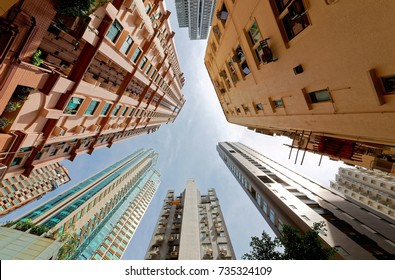 Low angle view of high-rise residential towers with crowded narrow apartments in a community near Central-Mid-Levels Escalator & Walkway system in Hong Kong, a phenomenon of severe housing shortage