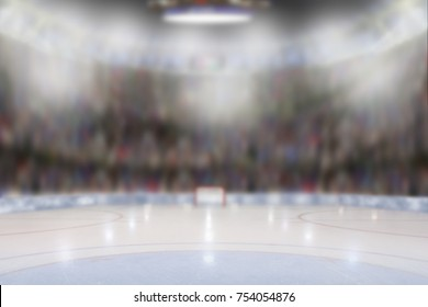 Low angle view of hockey arena with sports fans in the stands. Focus on foreground with deliberate shallow depth of field on background.