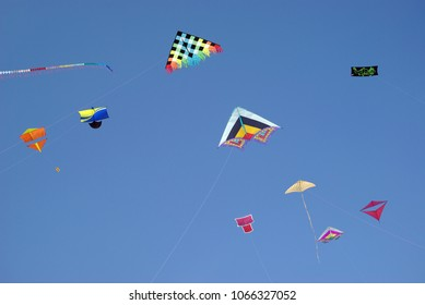 Low angle view of kites flying against clear sky
