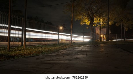 Low angle view of lights trail of vehicle at night.