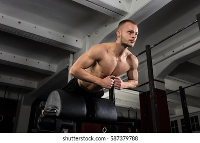 Low Angle View Of A Man Doing Core Exercise On Exercise Equipment In The Gym