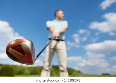 Low angle view of man holding golf club against sky