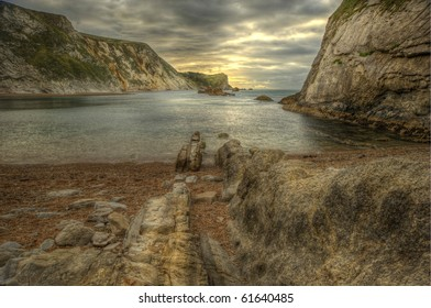Low angle view of Man O War cove on Jurassic Coast in England, HDR image