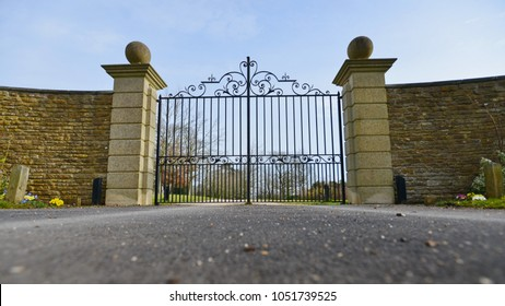 Low Angle View of a Mansion Gate and Drive