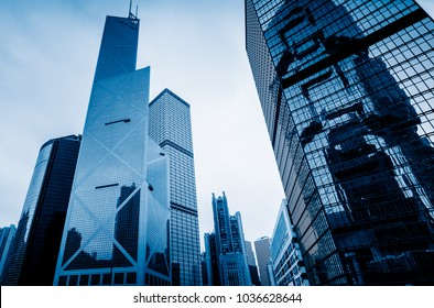low angle view of modern office block buildings in Hong Kong,blue toned,China.