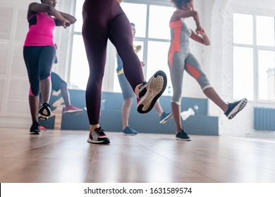 Low angle view of multicultural dancers practicing zumba in dance studio