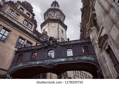 Low angle view of old dresden cathedral with clock and black arch in Dresden, Germany