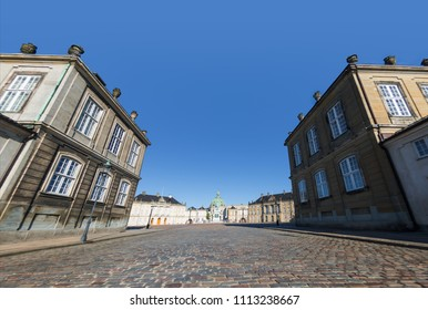 low angle view of old houses, pavement and Frederiks Church in copenhagen, denmark