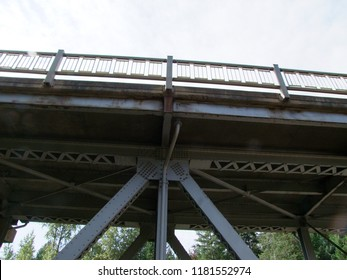 Low Angle view of an old, tall, metal vehicle bridge on a cloudy autumn day